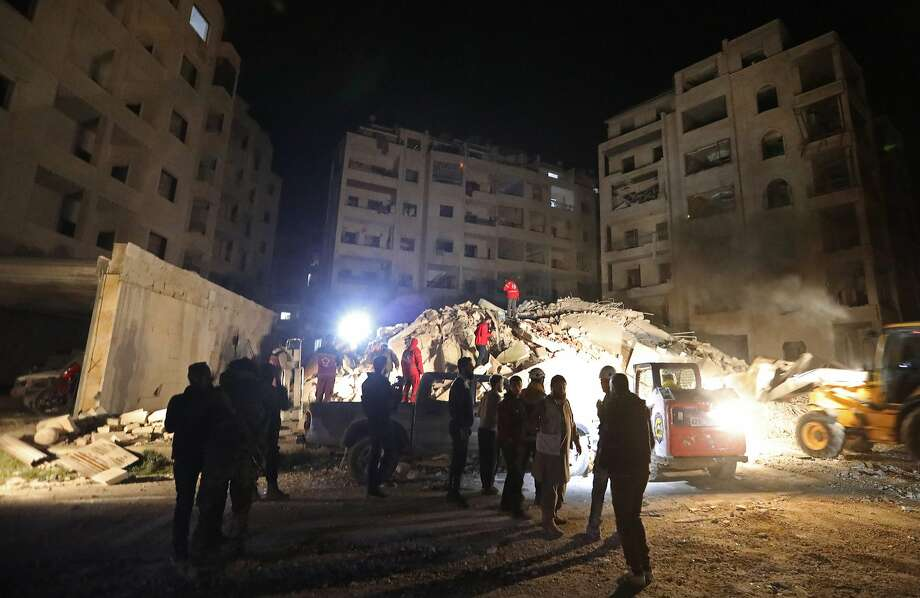 Emergency crews search for survivors in the rubble of a six story building that collapsed Sunday following Syrian government air strikes against rebel positions in Idlib province. Photo: OMAR HAJ KADOUR, AFP/Getty Images