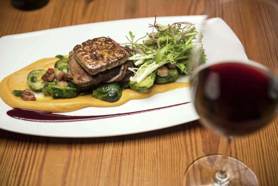 Grilled Szechuan peppercorn and five-spice crusted duck breast with seared foie gras from Bliss. Photo: Express-News File Photo