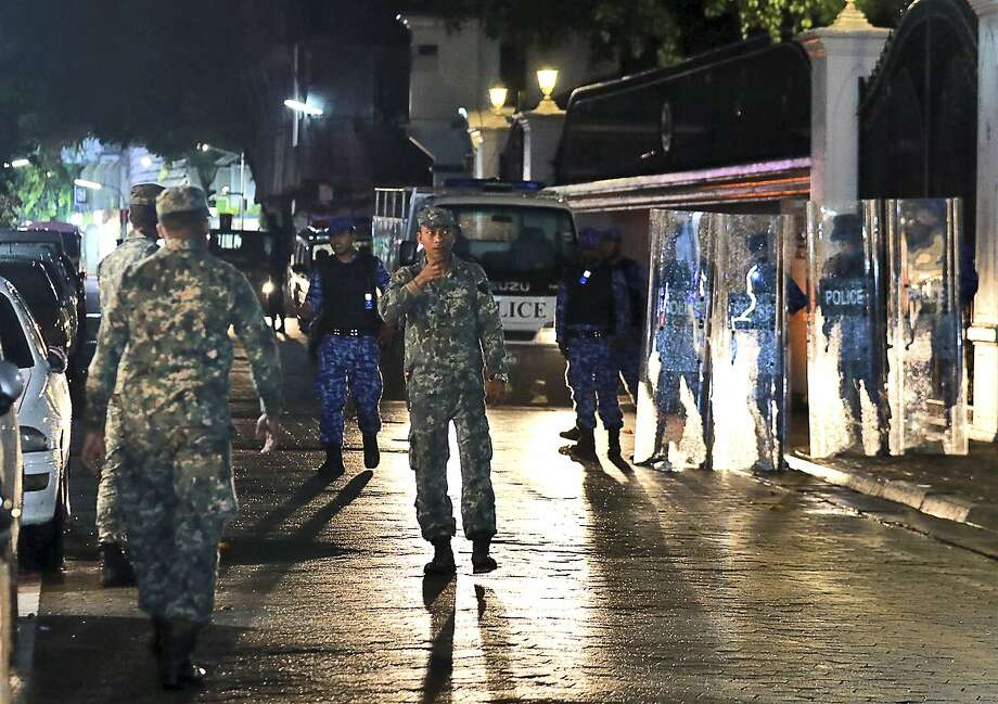 Troops patrol Male, the capital of the Maldives. The president and Supreme Court are mired in a standoff. Photo: Mohamed Sharuhaan, Associated Press
