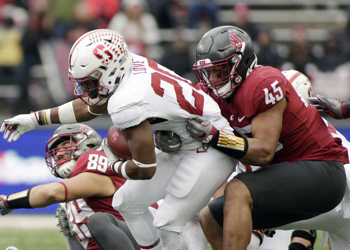 Washington State linebacker Logan Tago tackles Stanford running back Bryce Love during the second half of an NCAA college football game in Pullman, Wash., Saturday, Nov. 4, 2017.