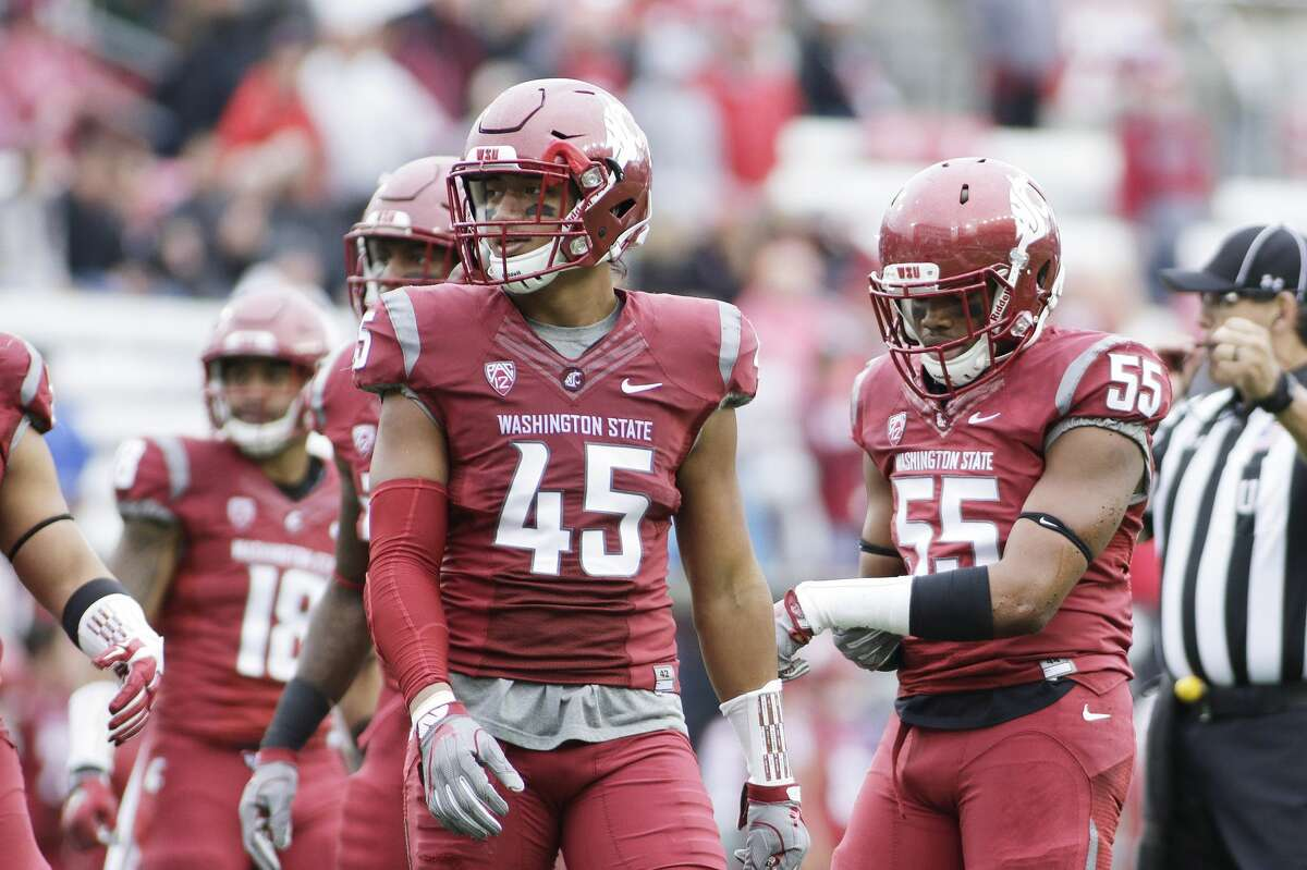 Washington State linebacker Logan Tago walks on the field during the second half of an NCAA college football game against Idaho in Pullman, Wash., Saturday, Sept. 17, 2016.