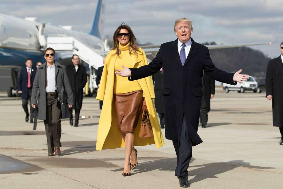 President and first lady Melania Trump arrive in Cincinnati. She visited a children's hospital to be briefed on the opioid epidemic, while he pitched the tax cuts that he recently signed into law. Photo: TOM BRENNER, NYT