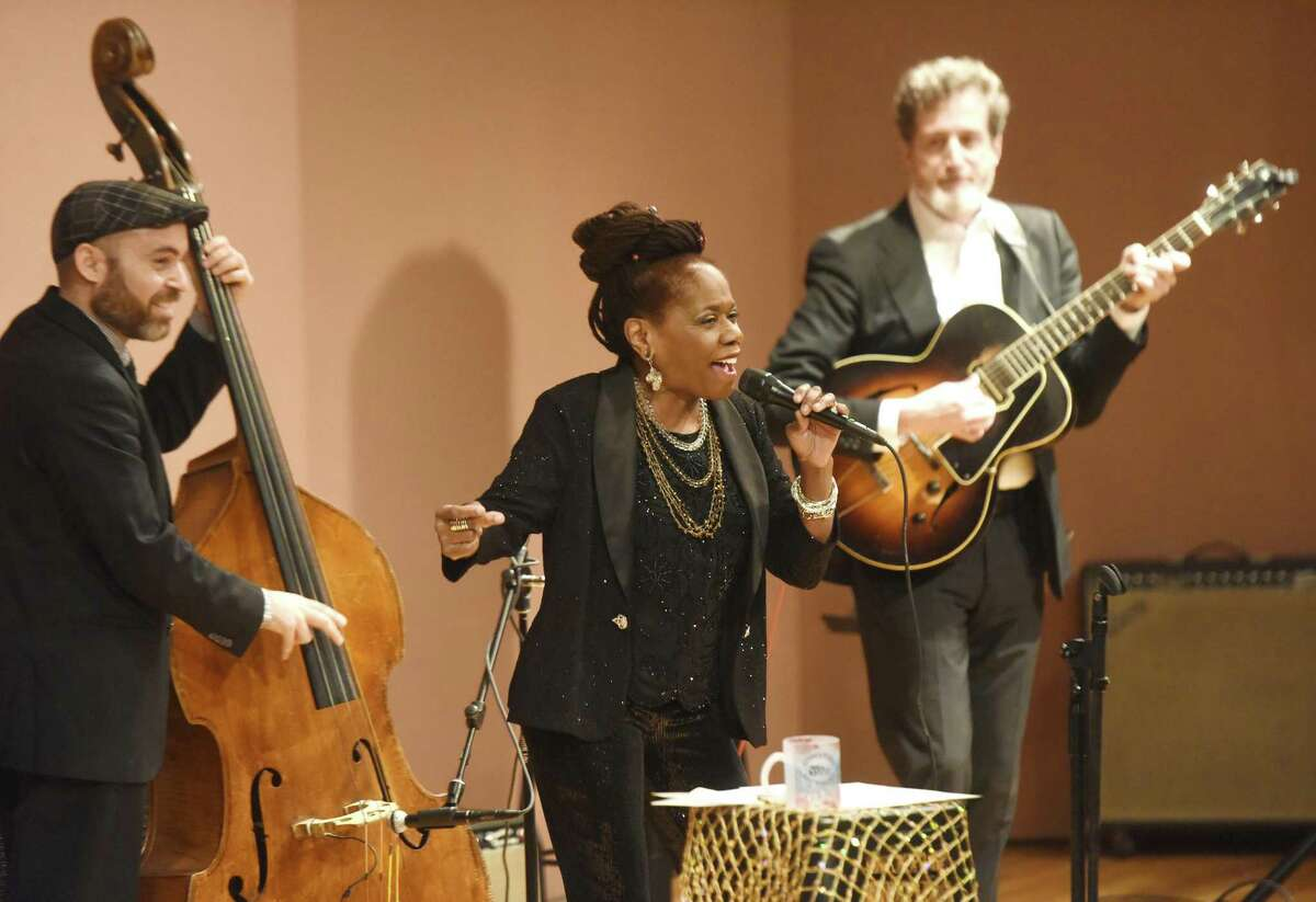 """Jazz singer Catherine Russell performs with bass player Tal Ronen, left, and guitarist Matt Munesteri at Greenwich Library's Cole Auditorium in Greenwich, Conn. Sunday, Feb. 4, 2018. Russell, whose most recent album """"Harlem on My Mind"""" was nominated for Best Jazz Vocal at the 2017 Grammy's, entertained a packed house with a lively set."""