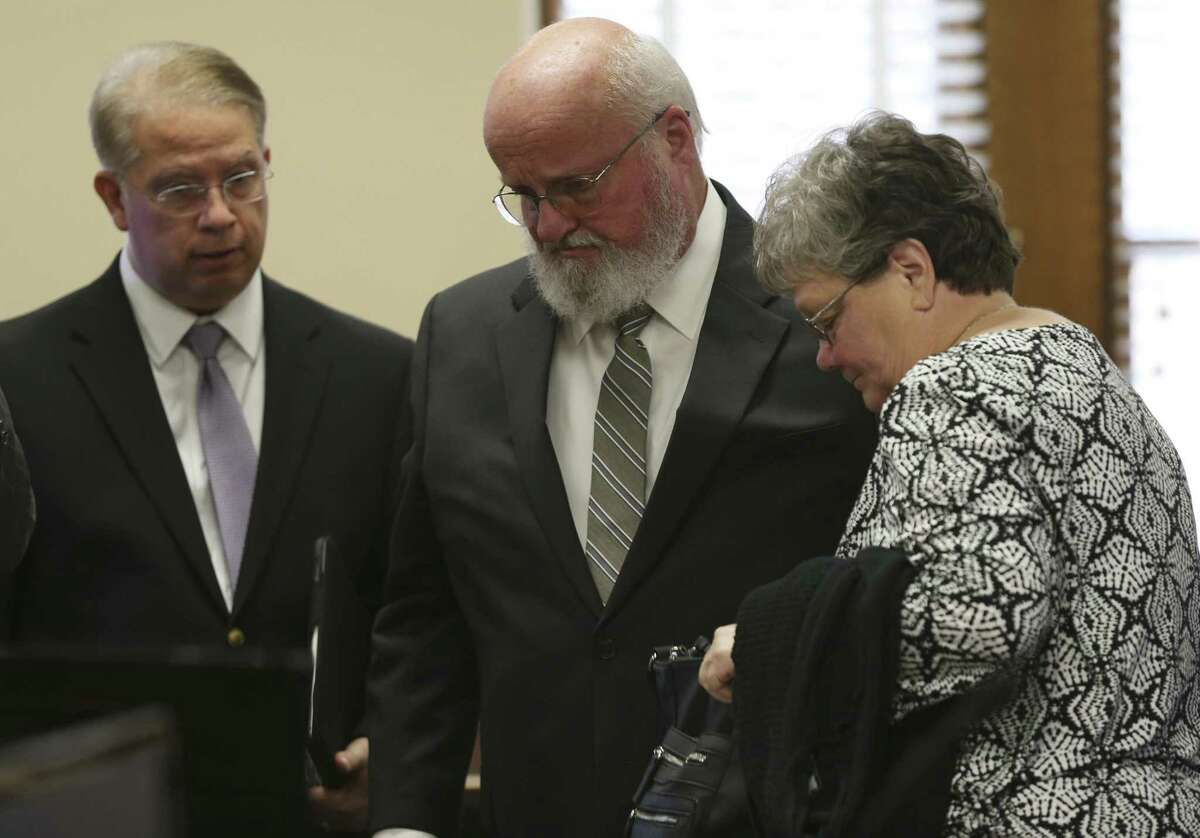 Timothy and Sharlotte Mott stand during a break in the Bexar County 131st District Court on Monday. The Mott family is suing Robert