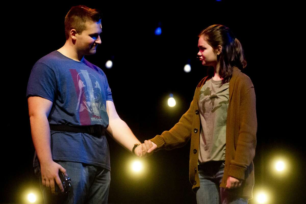 Emma Brown, as Miriam, right, and Fletcher Nowak, as Harold McClam, left, act out a scene during a dress rehearsal for Midland High School's production of