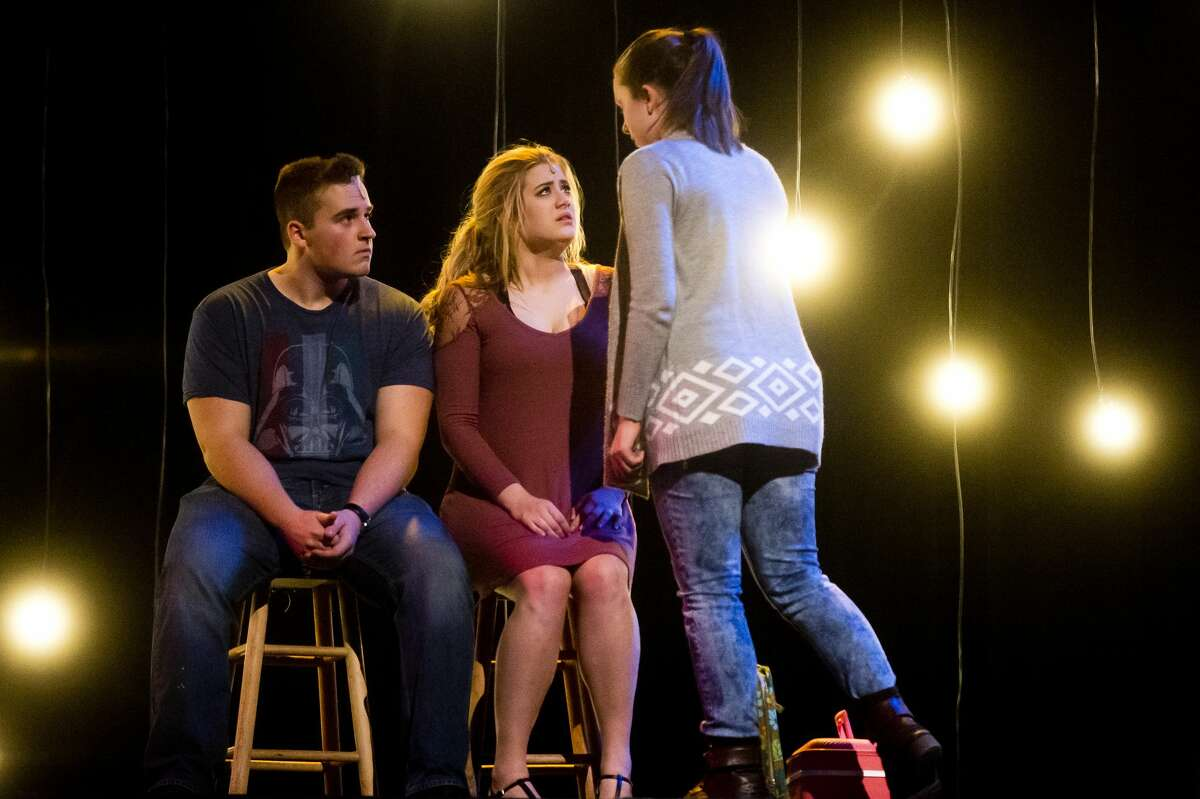 Students act out a scene during a dress rehearsal for Midland High School's production of