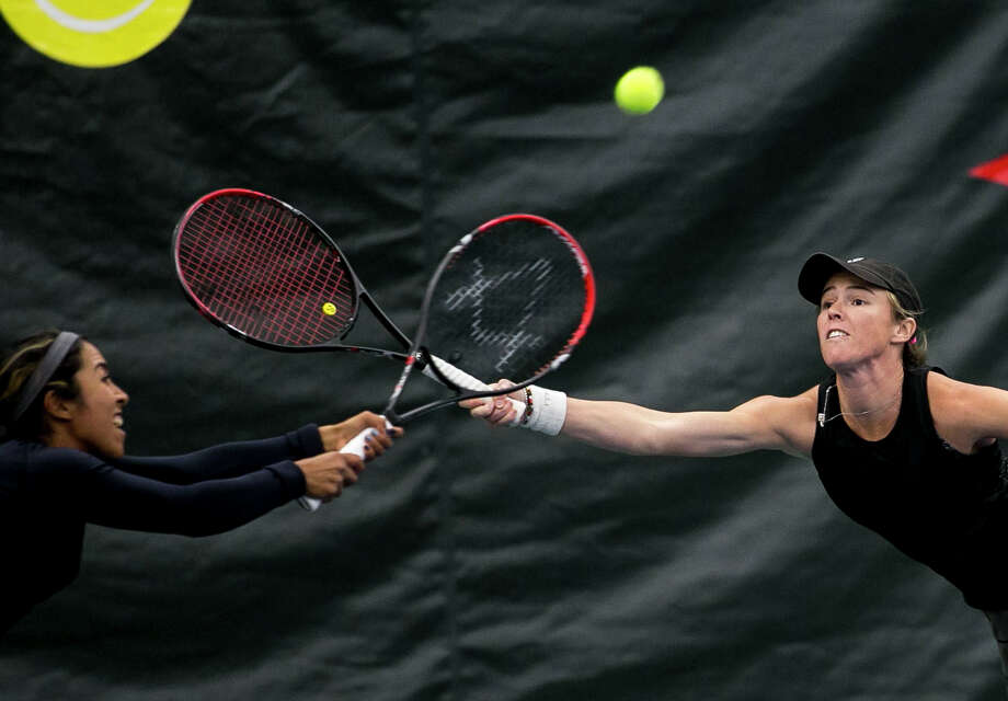 Sabrina Santamaria and Kaitlyn Christian go after the ball during the doubles final match during the Dow Tennis Classic held at the Greater Midland Tennis Center on Sunday, Feb. 4, 2018. (Josie Norris/for the Daily News) Photo: (Josie Norris/for The Daily News)