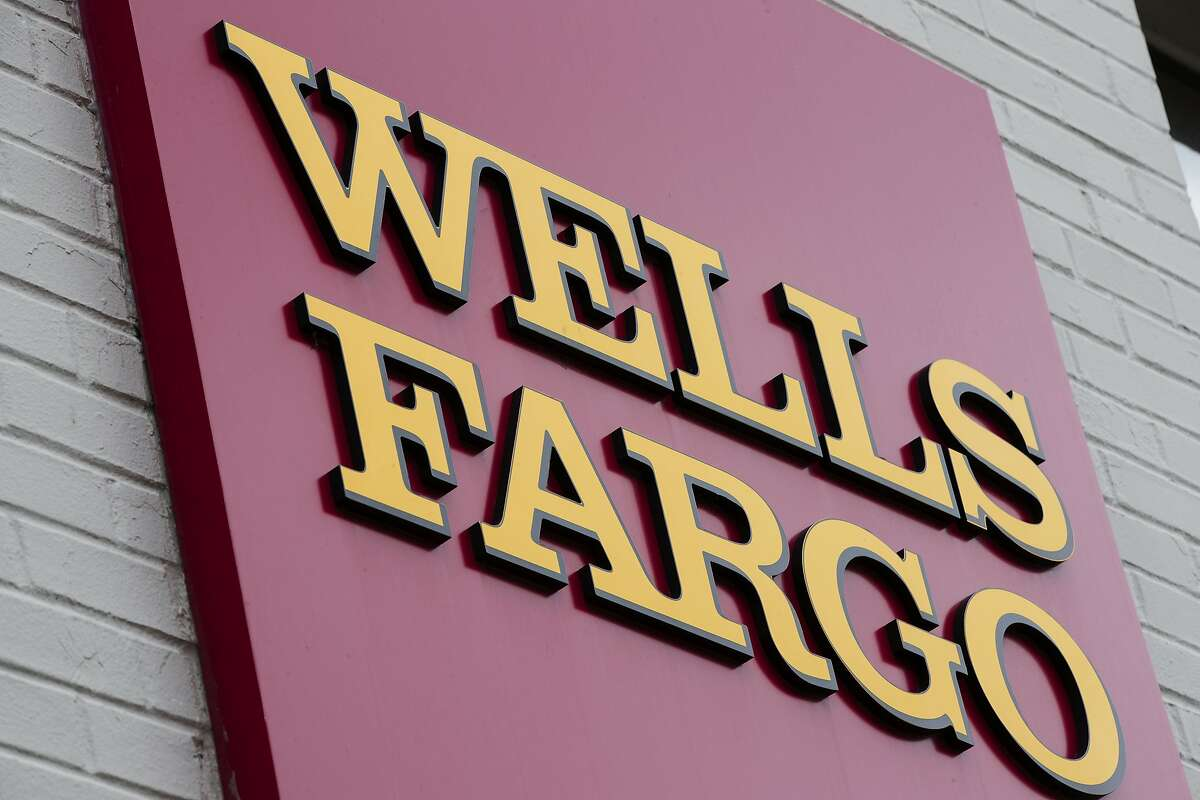 FILE - This Friday, Aug. 11, 2017, file photo shows a sign at a Wells Fargo bank location in Philadelphia. The Fed announced late Friday, Feb. 2, 2018, which was also Fed Chair Janet Yellen�s last day, that it was freezing Wells Fargo�s growth until it can prove it has improved its internal controls. The company�s stock slid more than 6 percent in Friday after-hours trading following the news, and are now down more than 9 percent in Monday premarket trading. (AP Photo/Matt Rourke, File)
