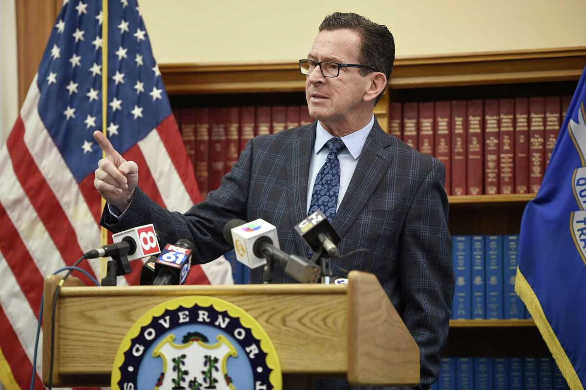 Gov. Dannel P. Malloy responds to a question during a news conference Monday, Feb. 5, 2018, at the State Capitol in Hartford, Conn., about the budget adjustments he is proposing for the 2019 fiscal year.