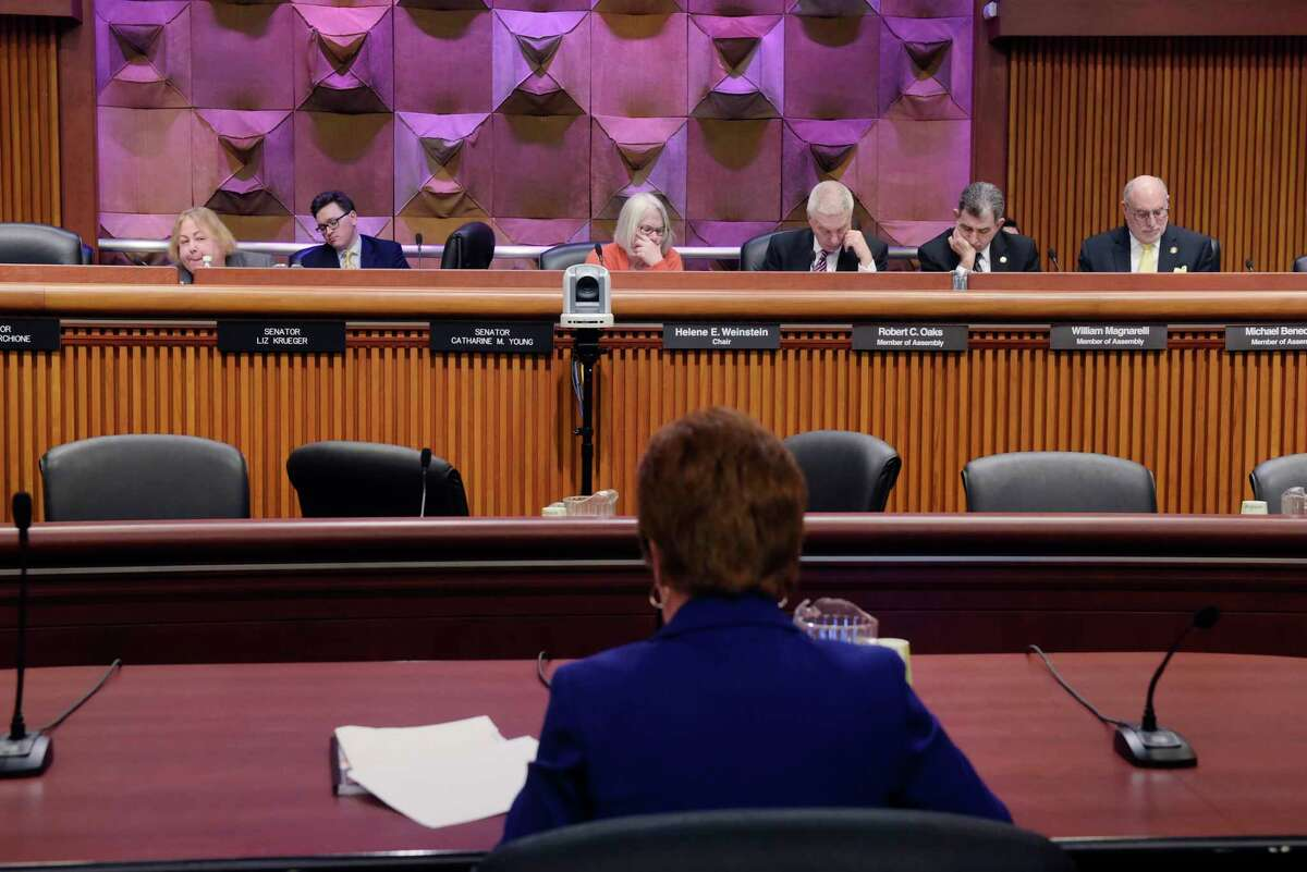 Legislators listen as Albany Mayor Kathy Sheehan testifies at a New York State Legislature joint budget hearing dealing with funding for cities on Monday, Feb. 5, 2018, in Albany, N.Y. (Paul Buckowski/Times Union)