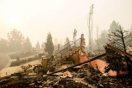 A staircase stands at a home leveled by the Tubbs Fire in the Fountaingrove area of Santa Rosa. The city's fire department has pinned the cause of two small October fires on PG&E's power lines. Neither fire, however, appears to have been connected to the Tubbs Fire, which destroyed several Santa Rosa neighborhoods.
