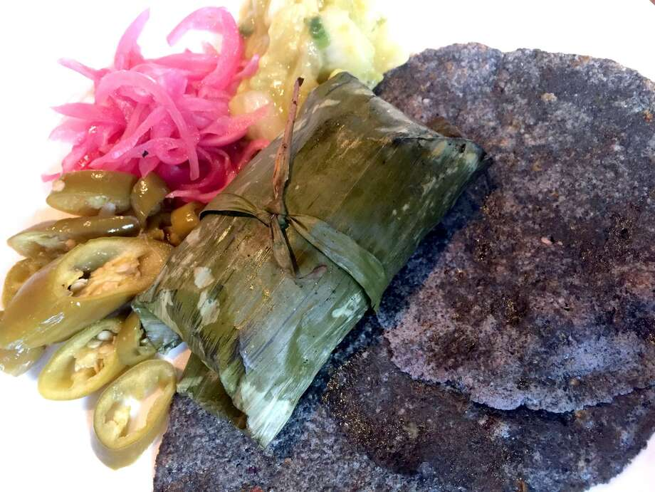 Pork gently cooked in a banana leaf and blue corn tortillas at Nao. Photo: Paul Stephen / San Antonio Express-News