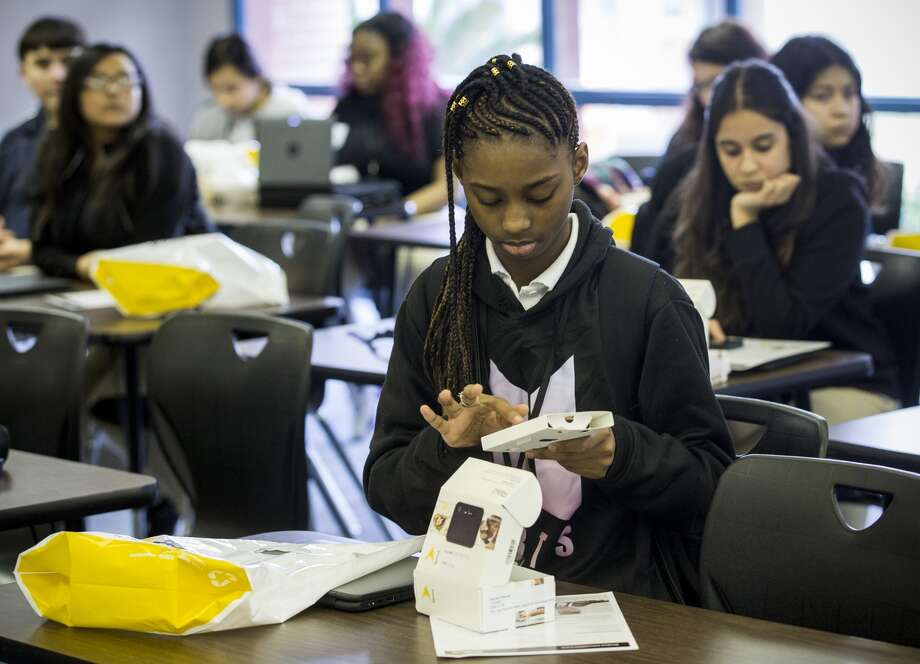 Jasmine Thomas opens up her new Sprint hot spot device at Sam Houston Math & Science Technology Center on Monday, Feb. 5, 2018, in Houston. Houston Independent School District rolled out a program that will give 14,000 high school students, without reliable internet connection at home and those displaced by Hurricane Harvey, connectivity devices needed to complete their schoolwork as part of the 1 Million Project. The students received free internet hot spot devices from Sprint. (Brett Coomer / Houston Chronicle )