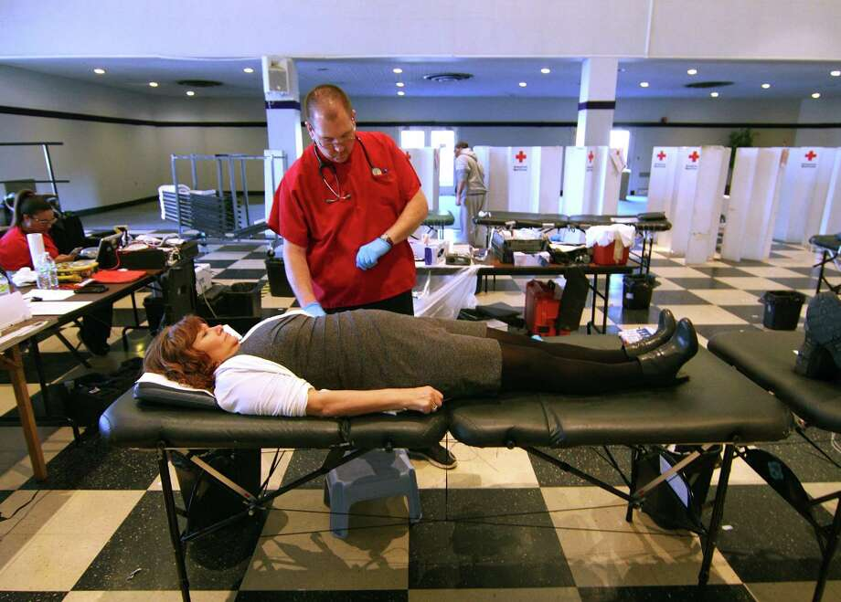 University of Bridgeport Event Coordinator Denise Brady donates blood during a Red Cross blood drive held at the school's student center in Bridgeport, Conn., on Wednesday Jan. 24, 2018. According to the American Red Cross, this brutal flu season has caused some potential donors to either cancel donation appointments or get turned away from donating due to illness. Photo: Christian Abraham / Hearst Connecticut Media / Connecticut Post