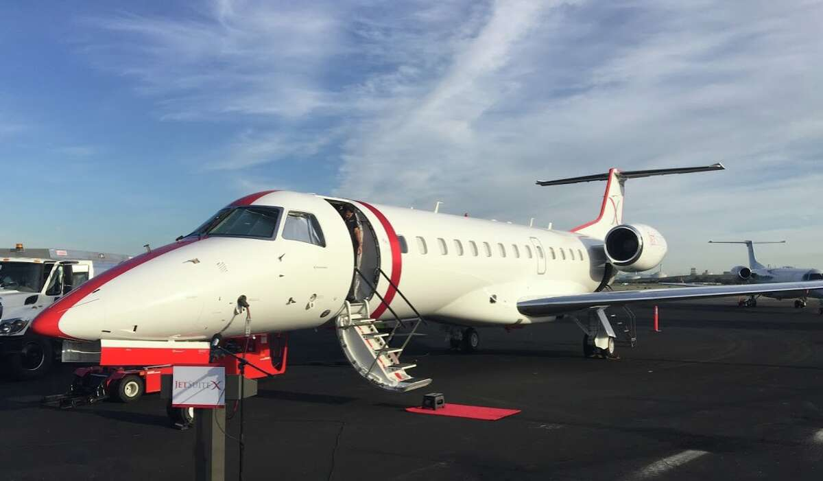 JetSuiteX Embraer jet all dressed up with a red bow for inaugural flights in 2016 at Concord airport