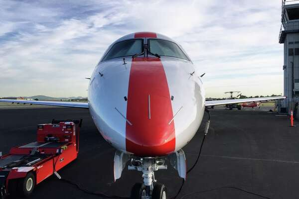 Full frontal view of a JetSuiteX Embraer 135 which flies between three Bay Area Airports and LA and Las Vegas