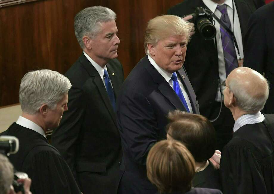 President Donald Trump greets Supreme Court justices, from left to right, Neil Gorsuch, Sonia Sotomayor and Stephen Breyer following his State of the Union address in the House Chamber Jan. 30. Photo: MANDEL NGAN /AFP /Getty Images / AFP or licensors