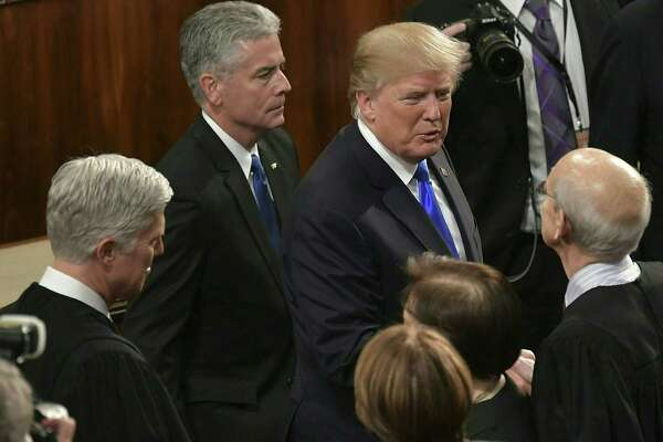 President Donald Trump greets Supreme Court justices, from left to right, Neil Gorsuch, Sonia Sotomayor and Stephen Breyer following his State of the Union address in the House Chamber Jan. 30.