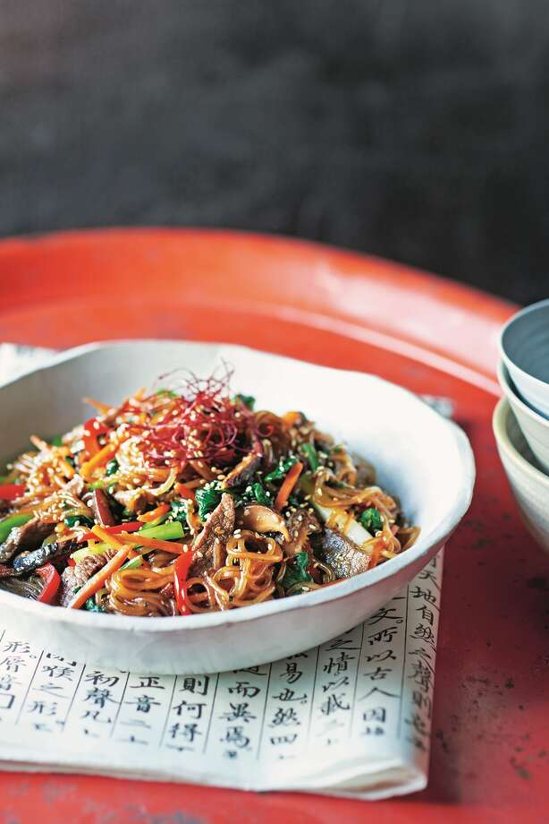 "Japchae (Stir-Fried ""Royal"" Noodles) is featured in ""K-Food: Korean Home Cooking and Street Food"" by Da-Hae and Gareth West. Photo: Mitchell Beazley"