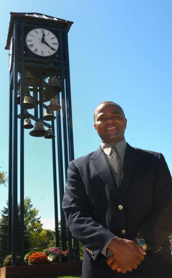 Dr. L. Oliver Robinson, superintendent of Shenendehowa schools, stands in front of a clock tower with vintage bells. (Luanne M. Ferris / Times Union) Photo: LMF / 00005447A