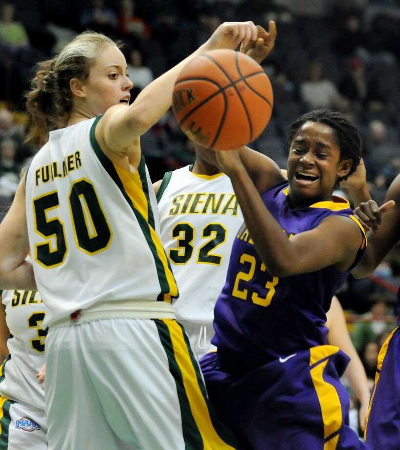 UAlbany's Charity Iromuanya, right, battles for the ball against Siena's Sarah Fullmer. (Cindy Schultz / Times Union) Photo: CINDY SCHULTZ