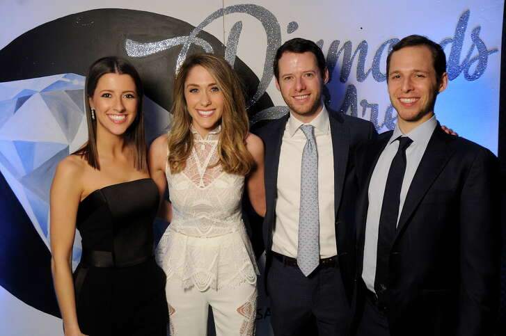 """From left: Kaitlin, Hilary, Blake and Eric Hellman at the Seven Acres Jewish Senior Care Services' """"Diamonds are Forever 75th Anniversary Gala""""at the Hilton Americas Hotel Saturday Feb. 03,2018. (Dave Rossman Photo)"""