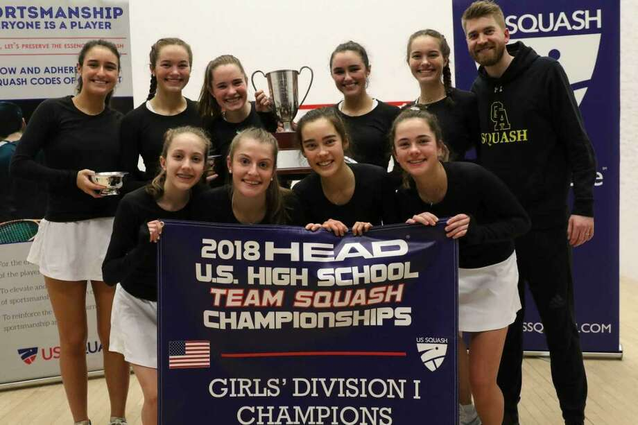 Greenwich Academy players and coach Luke Butterworth pose with the Patterson Cup and championship banner after winning the Division I title at the HEAD U.S. High School Team Squash Championships on Sunday at the Philadelphia Cricket Club in Philadelphia. Photo: Contributed Photo