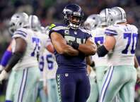 ARLINGTON, TX - DECEMBER 24:  Bobby Wagner #54 of the Seattle Seahawks reacts after the Dallas Cowboys missed a field goal in the fourth quarter at AT&T Stadium on December 24, 2017 in Arlington, Texas.  (Photo by Tom Pennington/Getty Images)