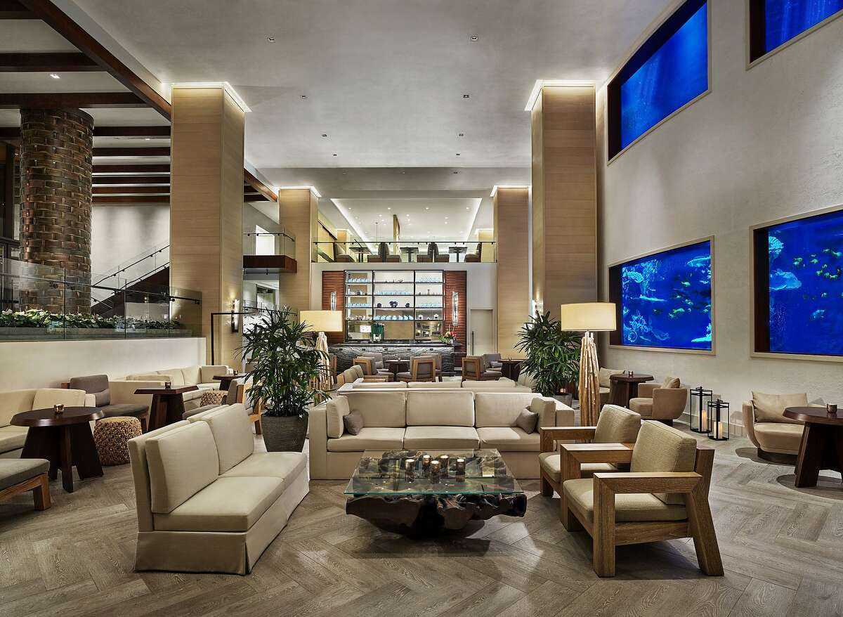 The soaring new lobby of Alohilani Resort Waikiki Beach includes windows into Oceanarium, home to more than 1,000 indigenous sea creatures.
