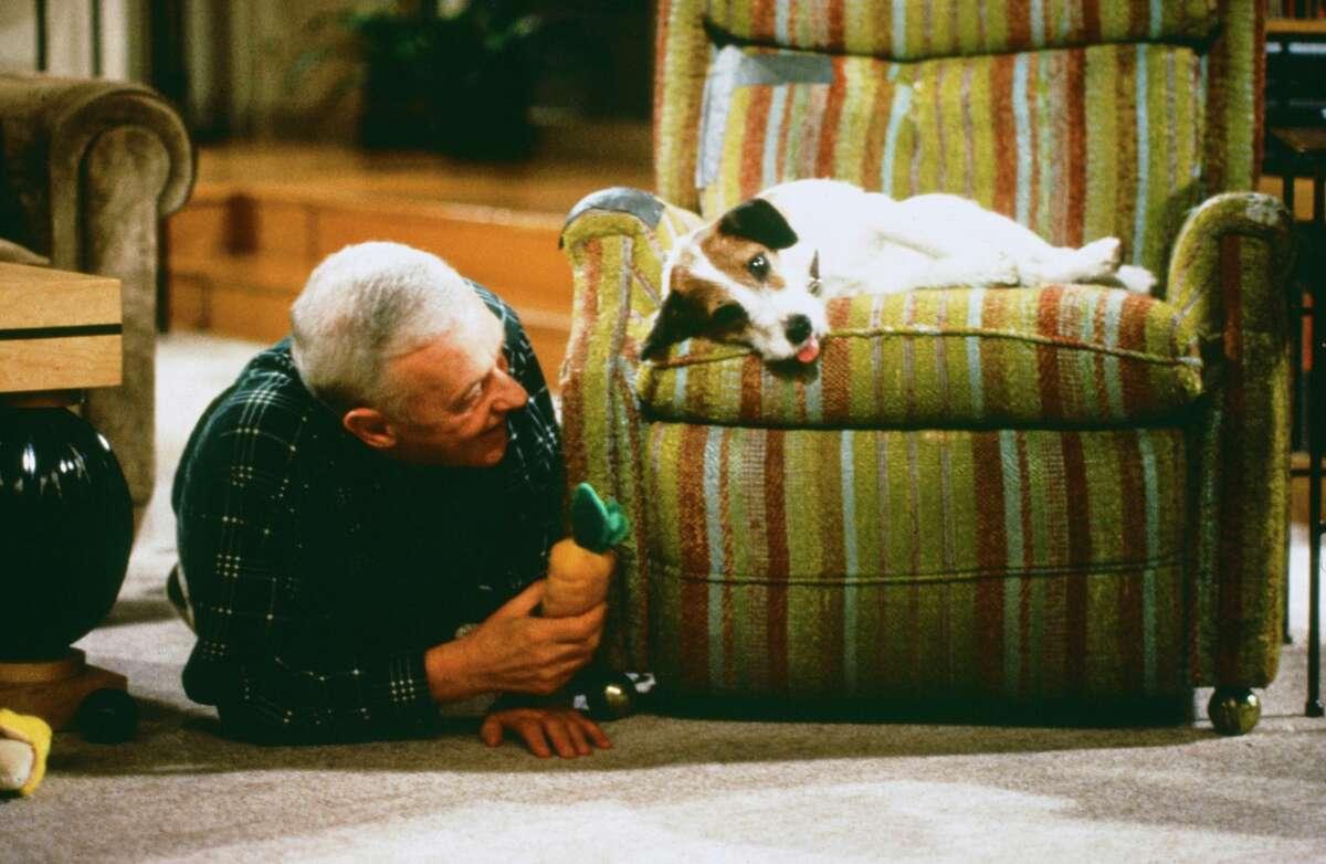 "John Mahoney as Martin Crane, Moose as Eddie from ""Fraiser."""