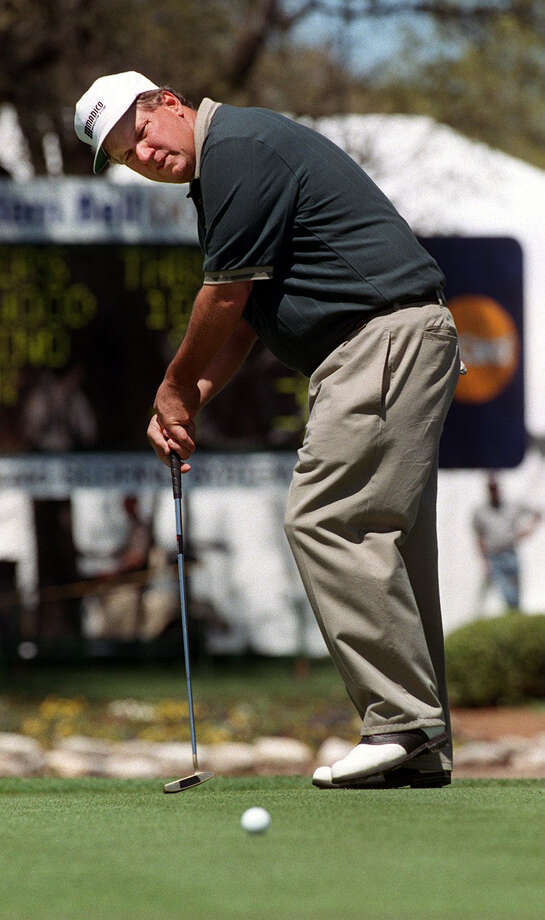San Antonian Kurt Cox grimaces and leans on his putter as he misses a putt during Friday's action of the Southwestern Bell Dominion senior golf tournament. Rick Hunter/Staff Photo: RICK HUNTER, SAN ANTONIO EXPRESS-NEWS / SAN ANTONIO EXPRESS-NEWS