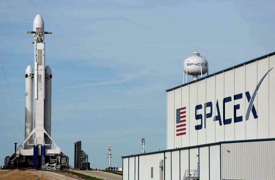 A Falcon 9 SpaceX heavy rocket stands ready for launch on pad 39A at the Kennedy Space Center in Cape Canaveral, Fla., Monday, Feb. 5, 2018. The Falcon Heavy scheduled to launch Tuesday afternoon, has three first-stage boosters, strapped together with 27 engines in all. (AP Photo/Terry Renna) Photo: Terry Renna, FRE / FR60642 AP