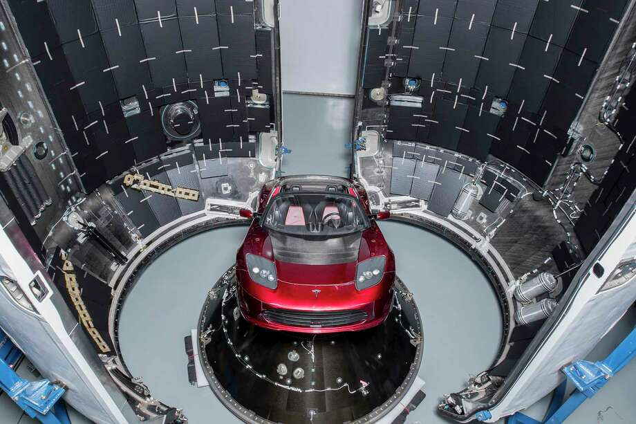 A photo provided by SpaceX of the cherry-red Tesla Roadster on the Falcon Heavy, a beefed-up version of SpaceX's workhouse Falcon 9 rocket. After years of delay, the Falcon Heavy, which will be able to carry more than 140,000 lbs. to low-Earth orbit, could launch by the end of January. (SpaceX via The New York Times) Photo: SPACEX, HO / SPACEX