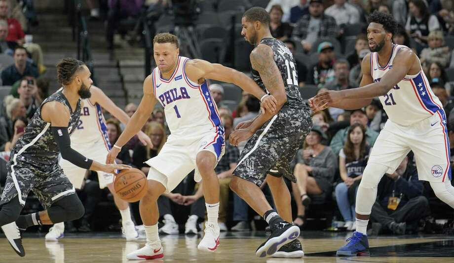 San Antonio Spurs' Patty Mills, left, drives against Philadelphia 76ers' Justin Anderson (1) and Joel Embiid (21) as Spurs' LaMarcus Aldridge attempts a screen during the second half of an NBA basketball game, Friday, Jan. 26, 2018, in San Antonio. Philadelphia won 97-78. (AP Photo/Darren Abate) Photo: Darren Abate, FRE / Associated Press / FR115 AP