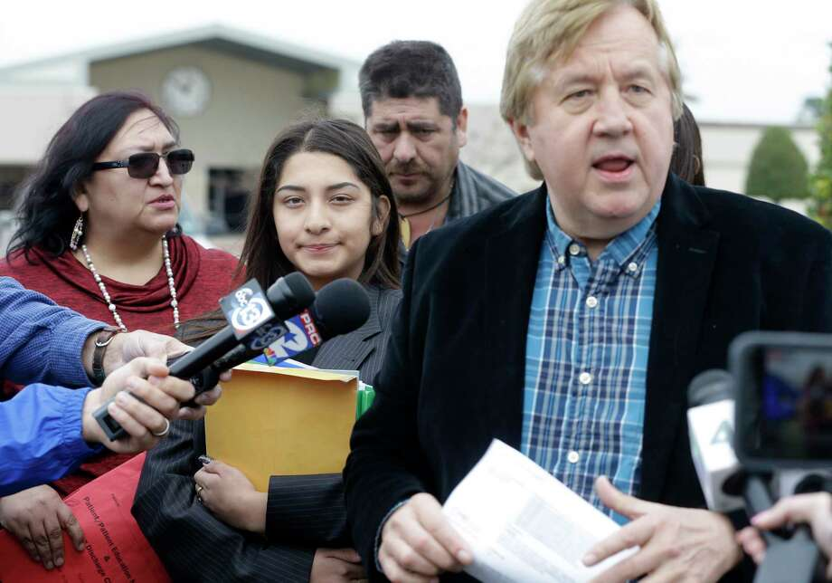 Attorney Randall Kallinen, right, speaks to the media about his client, Jazmin Garcia, 15, as she stands with her parents Mirna Garcia, left, and Ramon Garcia, during a media conference outside the Pasadena ISD Administration, 1515 Cherrybrook Lane, Monday, Feb. 5, 2018, in Pasadena. Jazmin, a freshman at Pasadena Memorial High School, was suspended for allegedly using drugs but said it was a medical condition that got her suspended. She said she felt dizzy in class and was taken to the nurse's office. Rather than calling her parents or an ambulance, school officials searched her shoes and person for drugs and asked her about prior drug use. She tested negative for drugs when her parents took her to see a doctor. ( Melissa Phillip / Houston Chronicle ) Photo: Melissa Phillip, Houston Chronicle / © 2018 Houston Chronicle