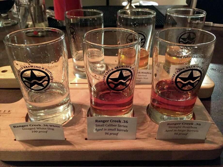 Flights of liquor at Ranger Creek. Photo: Paul Stephen /San Antonio Express-News