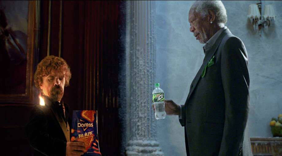 This photo provided by PepsiCo shows Peter Dinklage and Morgan Freeman in a scene from the company's linked Doritos Blaze and Mountain Dew Ice Super Bowl spots. For the 2018 Super Bowl, marketers are paying more than $5 million per 30-second spot to capture the attention of more than 110 million viewers. (PepsiCo via AP) Photo: HONS / PepsiCo
