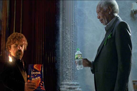 This photo provided by PepsiCo shows Peter Dinklage and Morgan Freeman in a scene from the company's linked Doritos Blaze and Mountain Dew Ice Super Bowl spots. For the 2018 Super Bowl, marketers are paying more than $5 million per 30-second spot to capture the attention of more than 110 million viewers. (PepsiCo via AP)