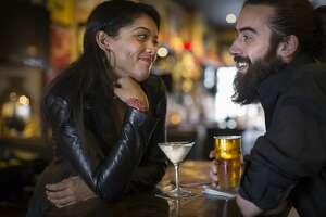 romantic couple having drinks at a pub/bar