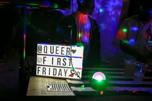 A sign is displayed near the DJ booth during the Queer First Friday celebration held at Temescal Brewery in Oakland, Calif., on Friday February 2, 2018.