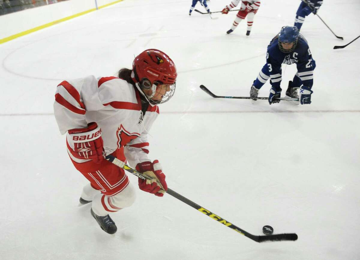 Greenwich's Emma Wingrove controls the puck in the high school girls hockey game between Greenwich and Darien at Dorothy Hamill Skating Rink in Greenwich, Conn. Monday, Feb. 5, 2018.
