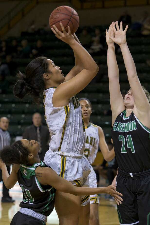 Midland College's Ella Tofaeono puts up a shot in the lane as Clarendon College's Kaleigh Stolz, 24, defends and Aleiyah Brantley tries to body block 02/05/18 at the Chaparral Center. Tim Fischer/Reporter-Telegram Photo: Tim Fischer/Midland Reporter-Telegram