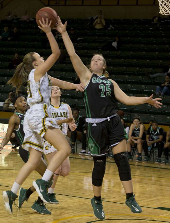 Midland College's Abbi Hatton puts up a shot as Clarendon College's Baily Shelor defends 02/05/18 at the Chaparral Center. Tim Fischer/Reporter-Telegram Photo: Tim Fischer/Midland Reporter-Telegram