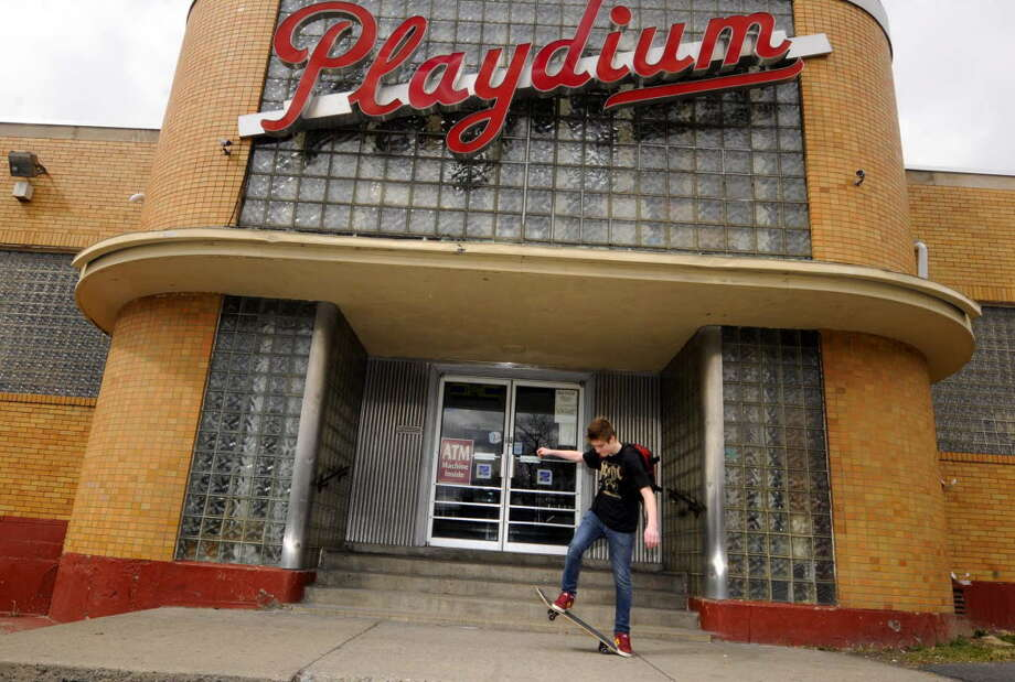 Fifteen-year-old James Clark rides his skateboard in front of the Playdium bowling alley in Albany March 19, 2011. The neighborhood bowling alley is closed and items will be auctioned off. ( Michael P. Farrell/Times Union ) Photo: Michael P. Farrell / 00012455A