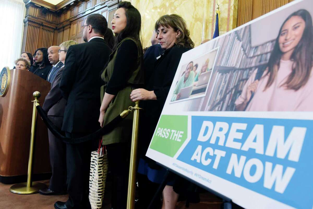 New York State Assembly Speaker Carl Heastie, surrounded by his fellow Assembly members, announces that the Assembly will take up and pass the Dream Act, during a press conference on Monday, Feb. 5, 2018, in Albany, N.Y. (Paul Buckowski/Times Union)