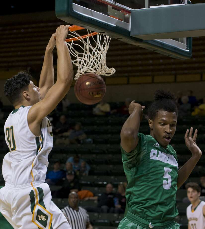 Midland College's Jarin van der Korput throws down a dunk as Clarendon College's Xavier Trent gets out of the way 02/05/18 at the Chaparral Center. Tim Fischer/Reporter-Telegram Photo: Tim Fischer/Midland Reporter-Telegram
