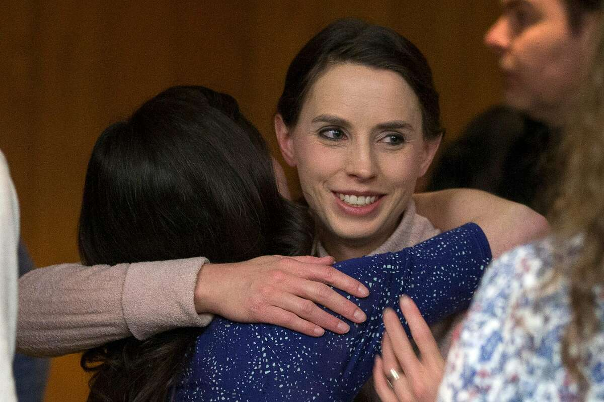Victims Rachael Denhollander (R) hugs Larissa Boyce (L) at the conclusion of the sentencing of Former Michigan State University and USA Gymnastics doctor Larry Nassar in Eaton County Circuit Court on February 5, 2018 in Charlotte, Michigan. Michigan State University has reached a $500 million settlement with hundreds of women and girls who say they were sexually assaulted by sports doctor Larry Nassar in the worst sex-abuse case in sports history.