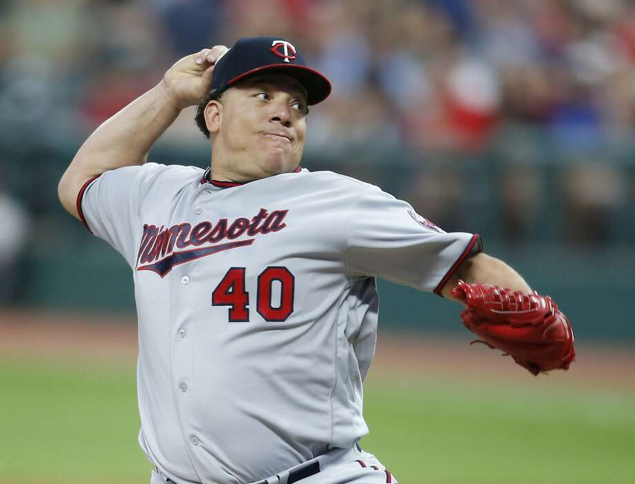 File-This Sept. 26, 2017, file photo shows Minnesota Twins starting pitcher Bartolo Colon throwing against the Cleveland Indians during the first inning in a baseball game in Cleveland. Colon has agreed to a minor league contract with the Texas Rangers, and the 44-year-old right-hander will attend big league spring training. Colon would get a $1.75 million, one-year contract if added to the 40-man roster under the terms of the deal agreed to Sunday, Feb. 4, 2018.  (AP Photo/Ron Schwane, File) Photo: Ron Schwane, Associated Press