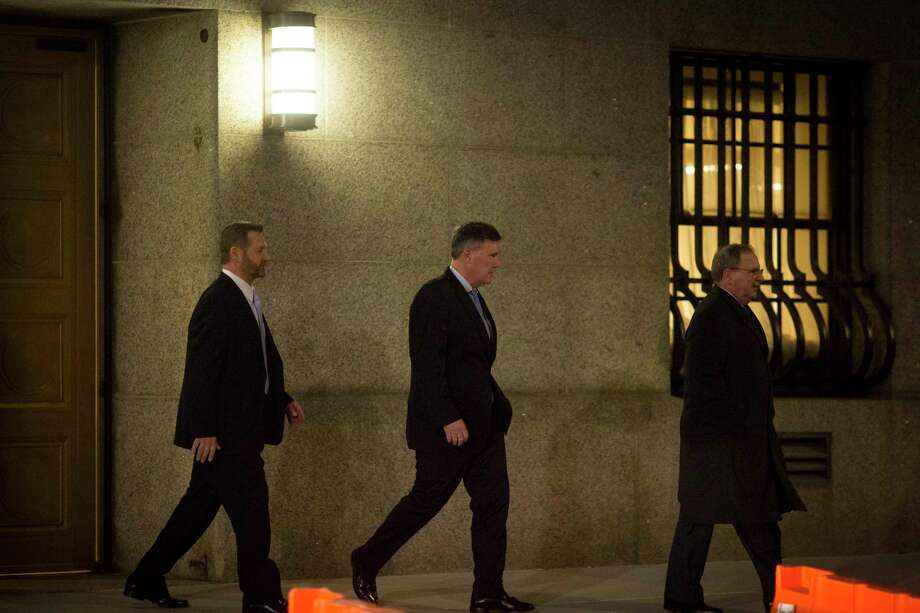 Todd Howe, center, leaves the Thurgood Marshall United States Courthouse after his first day of testimony in the corruption case against Joseph Percoco, in New York, Feb. 5, 2018. Howe, a cooperating witness who has pleaded guilty, offered a vivid and sometimes sordid look at the inner workings of Albany. (Dave Sanders/The New York Times) Photo: DAVE SANDERS / NYTNS