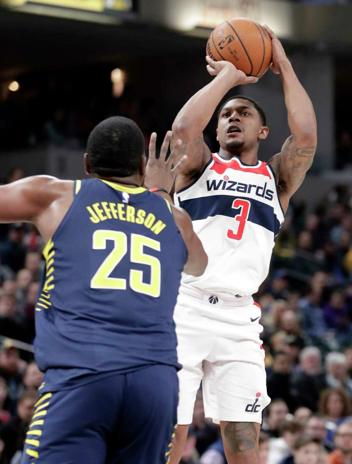 Washington Wizards guard Bradley Beal (3) shoots over Indiana Pacers center Al Jefferson (25) during the first half of an NBA basketball game in Indianapolis, Monday, Feb. 5, 2018. (AP Photo/Michael Conroy)